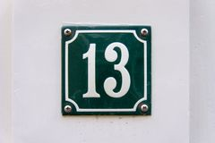 House number thirteen 13. Enameled house number thirteen 13 Stock Images