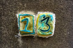 House number thirteen 13. Hand made Stock Images