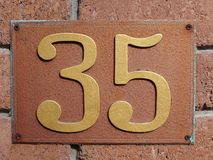 House number thirty five. House door number plate thirty five. House number thirty five royalty free stock images
