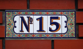 House number tile plaque with floral ornament Royalty Free Stock Photography