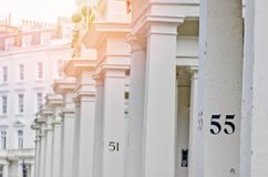 House number 55 on white pillar in London. Royalty Free Stock Photos