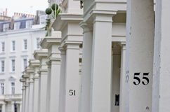 House number 55 on white pillar in London. Royalty Free Stock Images