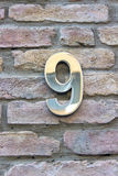 House number 9 zinc plate Stock Images