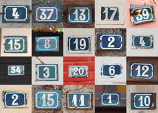 House numbers. Collage of weathered house numbers on the wall Stock Image