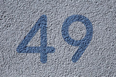 House numbers forty nine  on the wall Royalty Free Stock Images