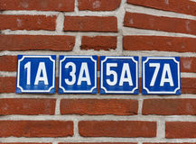 House numbers on wall Stock Photos