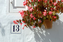 House numer 13. Spanish House number and mailbox with flowerpot Royalty Free Stock Photography