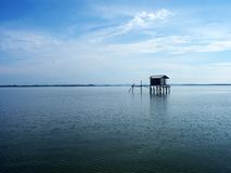The house in the ocean for fishing. The little house in the blue ocean for fishing. sightseeing seascape stock photography