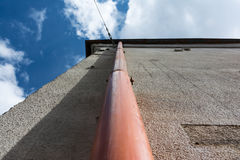 House Old Drain Pipe Gutter Closeup Sky Vertical Perpsective Cor royalty free stock image