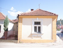 House with old window. Yellow house with old window in Aleksinac, Serbia Royalty Free Stock Photos