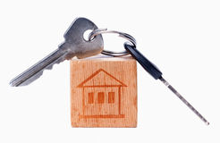 House on the old wooden cube with keys Royalty Free Stock Image