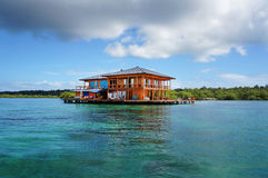 Free House On Stilts Over Water Of The Caribbean Sea Stock Image - 38114861