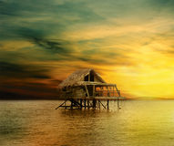 Free House On Wooden Stilts In The Middle Of The Ocean Royalty Free Stock Photo - 14620425