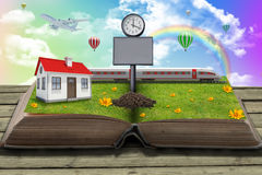 House on open book with grass Stock Photography