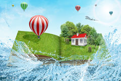 House on open book with jet Royalty Free Stock Photography
