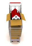 House in an open cardboard box, standing on trolle Royalty Free Stock Images