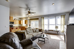 House with open floor plan. Family room and kitchen area. Room has exit to backyard area royalty free stock photo