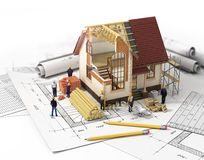 House with open interior on top of blueprints, documents and mor Stock Photography