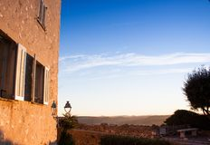 House with open shutter in the blue sky stock photo