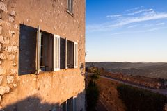 House with open shutter in the blue sky Stock Photography