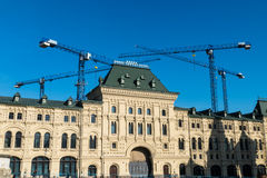 The house opposite the Kremlin and construction cranes. Russia 2016 March 10 royalty free stock image