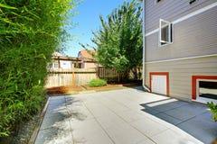 House with orange trim. Backyard view Stock Image
