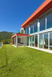 House, outdoor view. Beautiful house, modern style, view from the garden royalty free stock image