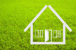 House outline. On grass background royalty free stock photos