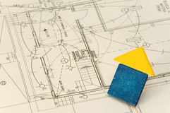 House over construction plans. Wood board house over some technical drawing Royalty Free Stock Images