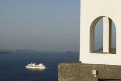 House over sea greek island. Greek island house over sea with cruise ship santorini Stock Images