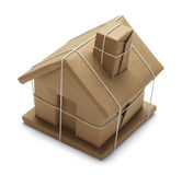 House Package. House Wrapped up In Brown Paper And Rope Isolated on White Background Royalty Free Stock Photos