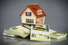 House on packs of banknotes Stock Photos