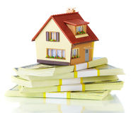 House on packs of banknotes Stock Photo