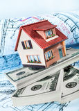 House on packs on a blue print. Stock Photo