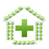 House from packs of green tablets Royalty Free Stock Photos