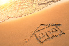 House painted on beach sand. Travel. Sea. Stock Photos