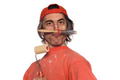 House painter. Comical portrait of the house painter with a brush and the platen Royalty Free Stock Image