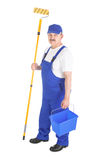 House painter in blue dungarees over white Stock Image