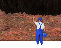 House painter covers brick wall Royalty Free Stock Images