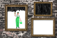 House painter covers inside of three frames Stock Photo