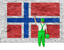 House painter covers wall with flag of Norway Stock Images