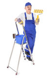 House painter with ladder on white stock photography