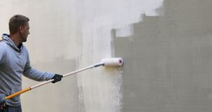 House painter painting building exterior stock footage