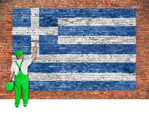 House painter paints flag of Greece on brick wall. House painter paints flag of Greece on old brick wall Royalty Free Stock Photo