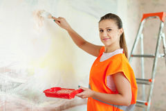 House painter paints wall with brush Royalty Free Stock Image