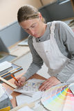 House painter preparing color samples. House painter preparing colour sample for house painting Stock Image