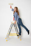 House painter woman. Standing on stepladder Stock Image