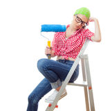 House painter woman. House painter. Sleepy woman with paint roller, isolated on white. Lazy female worker on renovation or wall painting Stock Photo