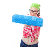 House painter woman. House painter. Smile woman with a paint roller holding it out at arms while painting a wall, roller in a focus ,isolated on white Stock Photography