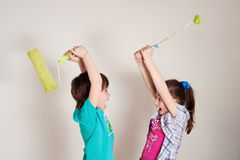 House-painters. Children playing house-painters and making fun Stock Photo
